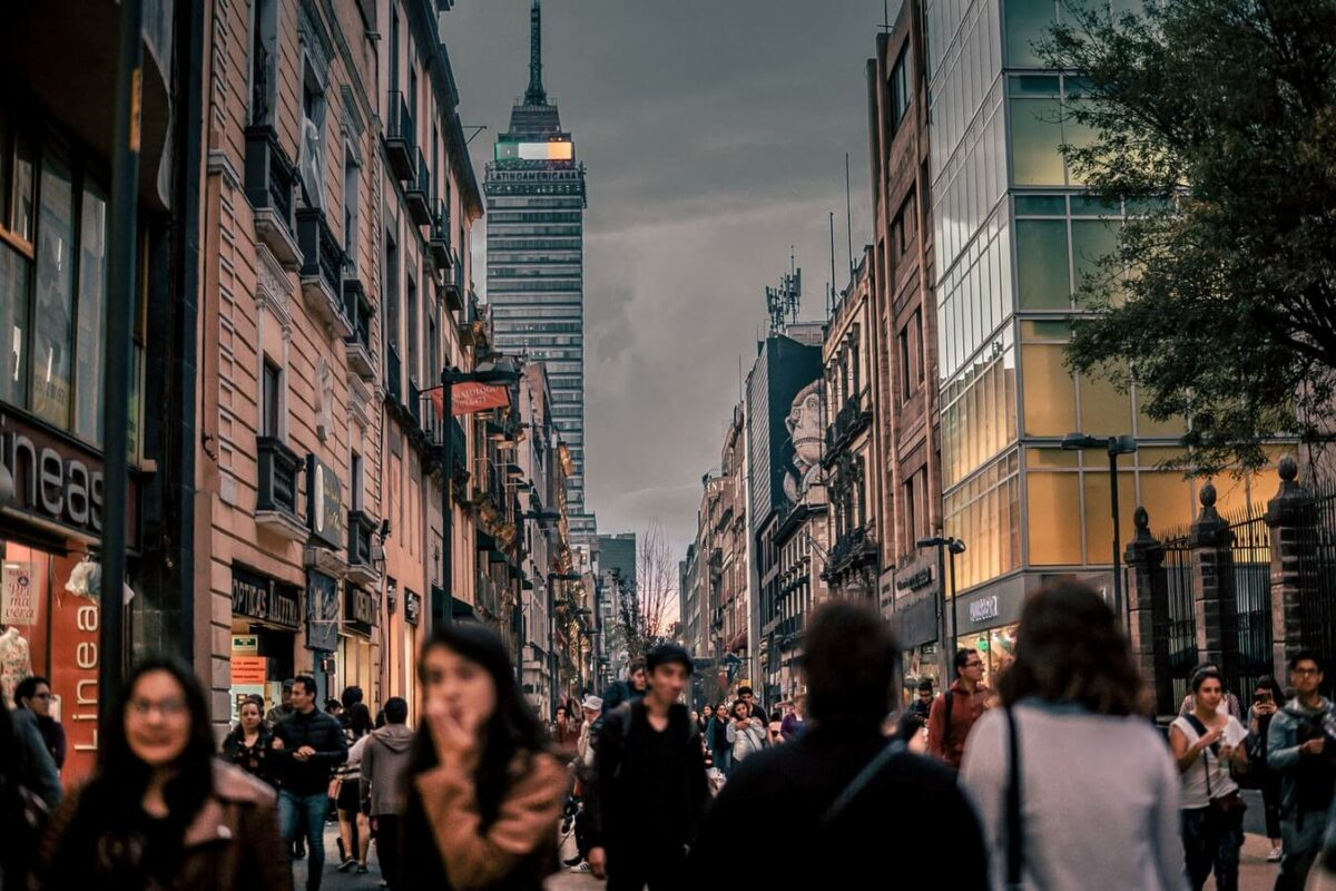 Photo of young professionals walking in street in Mexico City