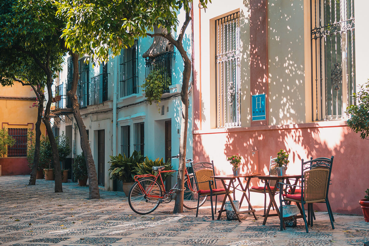 Photo of patio furniture and a bike in a courtyard in Sevilla, Spain