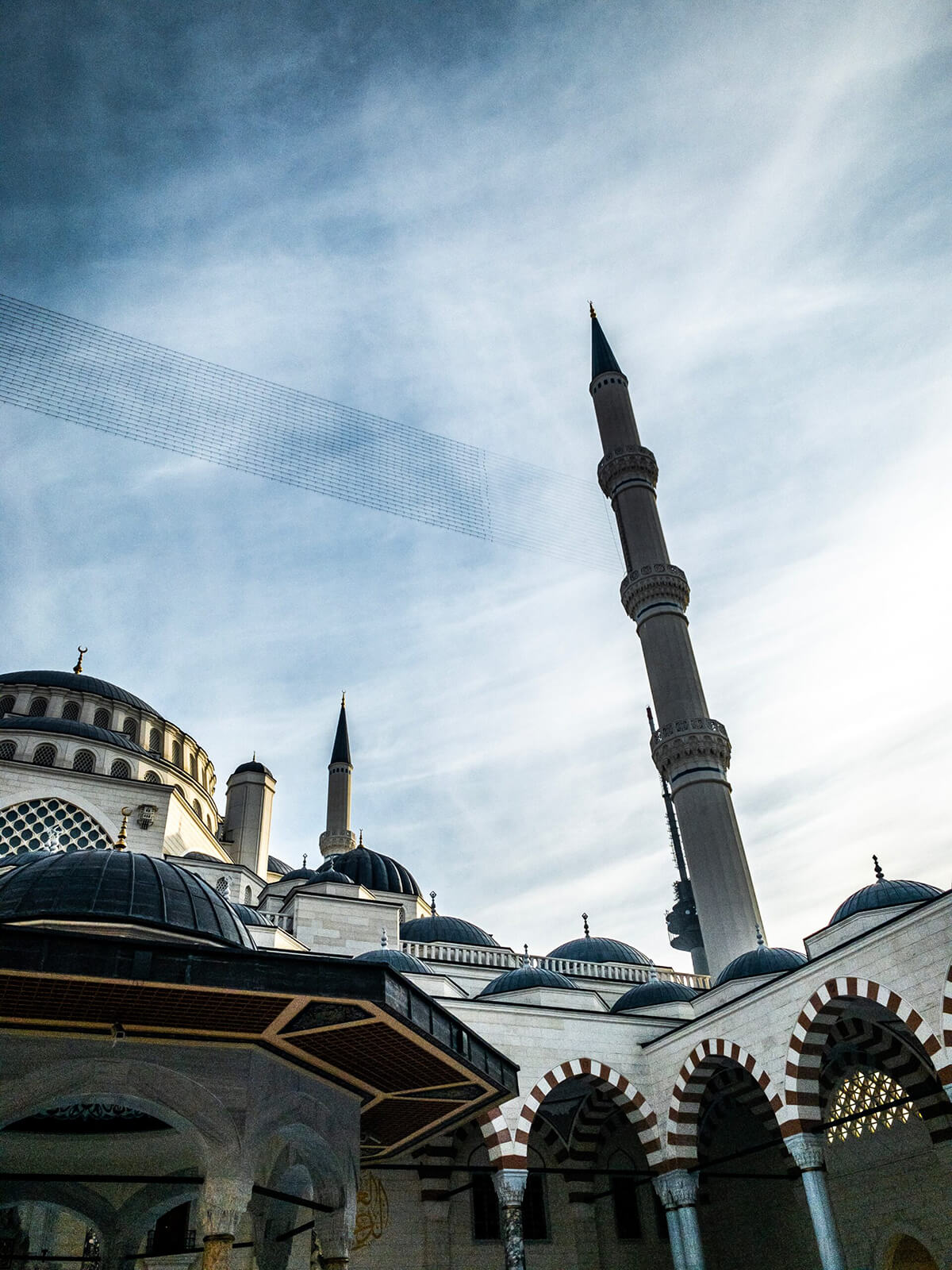 Photo of a white and black mosque building